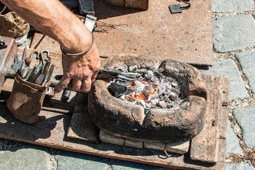 Craftsman hand forging metal