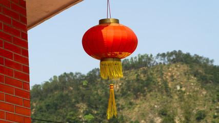Chinese red lantern decorating a Ten Thousand Buddhas Monastery in Hong Kong, China