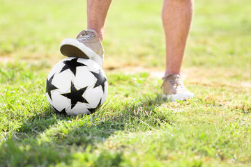Man with with soccer ball outdoors