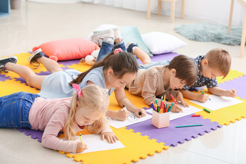 Cute little children drawing in kindergarten