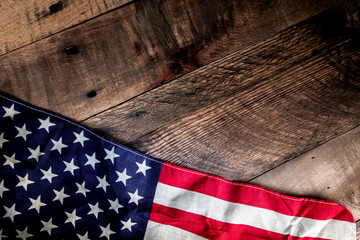 USA Flag draped across rustic background