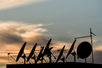 silhouette of antenna dish, photo as background