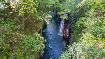 Wall Mural - Takachiho Gorge with boat and waterfall in Miyazaki, Japan time lapse