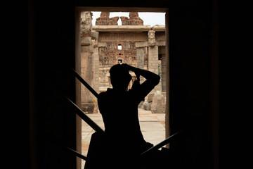 Hampi, India July 9, 2019 : Photographer capturing the photo of ruined Vittala Temple in Hampi, Karnataka, India