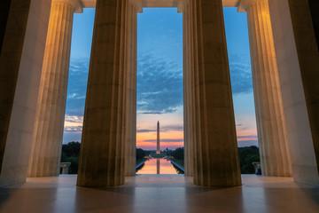 Lincoln Memorial at Sunrise, view at Washington Monument and Reflecting Pool in Washington, D.C., USA.