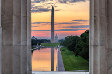 Washington Monument and Reflecting Pool at sunrise from Lincoln Memorial in Washington, D.C., USA.