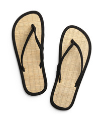 Pair of stylish flip flops on white background, top view