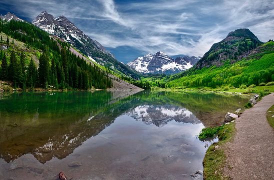 Maroon Bells reflections in calm clear water of Maroon Lake near Aspen. Colorado. United States of America