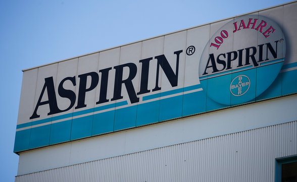 Logo of Bayer is pictured on a billboard for its painkiller Aspirin at the headquarters in Leverkusen