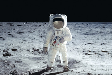 Fotorolgordijn Nasa The astronaut goes across the Moon, in a white space suit Elements of this image were furnished by NASA