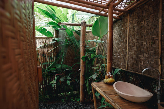 Outdoor shower in nature Bamboo wood surrounded Giving a natural feeling of freshness.Tropical Outdoor Shower on bamboo wall