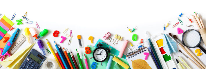 Set of different stationery, alarm clock and supplies on white background. Back to school concept. Banner format. Top view. Wall mural