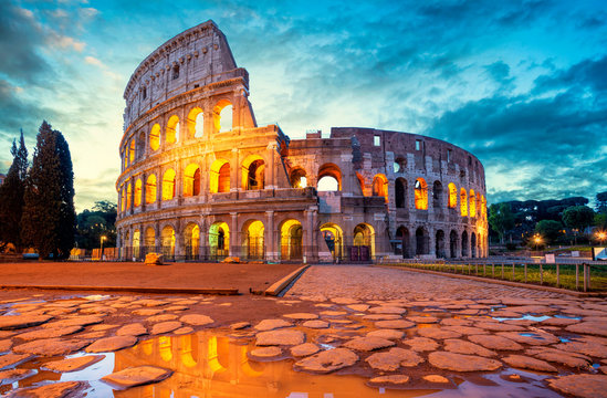 Colosseum morning in Rome, Italy. Colosseum is one of the main attractions of Rome. Coliseum is reflected in puddle. Rome architecture and landmark.