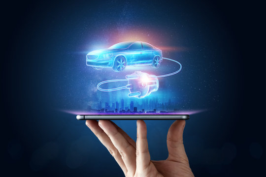Creative background, Electric car with charging wire, hologram. The concept of electromobility e-motion, charging for the car, modern technology