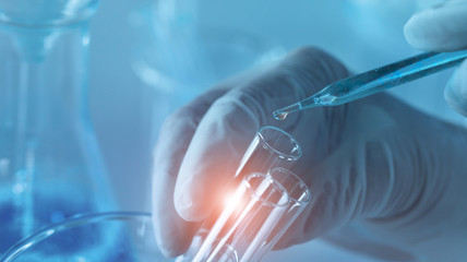 Genetic research and Biotech science Concept. Human Biology and pharmaceutical technology on laboratory background.