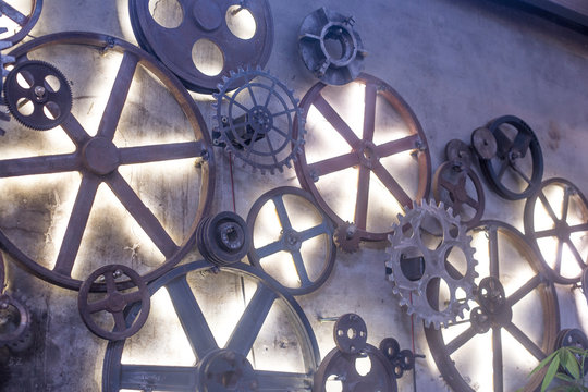 Vintage cogs gears wheels on the wall