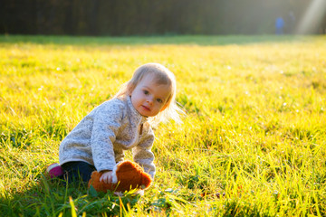 baby girl playing on a grass