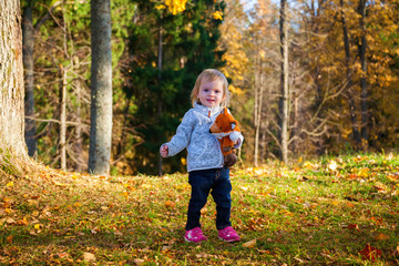 baby girl with a fox toy