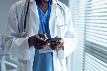 Male doctor using mobile phone in hospital