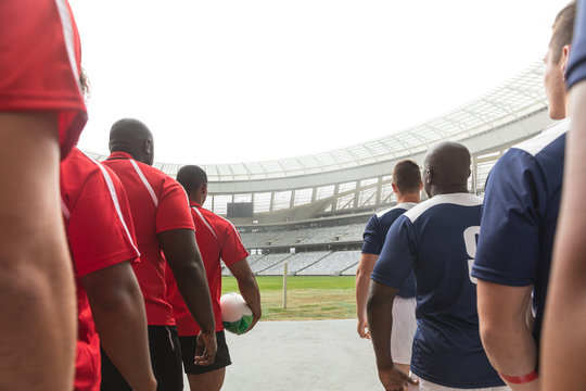Rugby teams standing in a row at the entrance of stadium for match