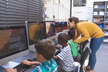 Teacher teaching student in computer room