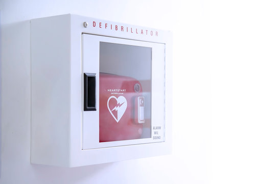 Automated External Defibrillator (AED) in white box on the wall Is an emergency pacemaker device for people with cardiac arrest. Heart defibrillator on white background.