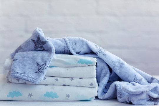 set for a boy, muslin diaper, fleece pajamas, background.