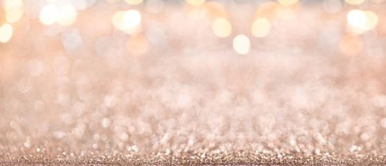 Christmas background. Abstract gold holiday panoramic backdrop with Defocused glitter, Blinking...