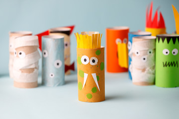 Decoration for Halloween home party - monsters made with toilet paper roll. Handicraft Monsters, concept of eco-friendly reuse recycle diy creative idea