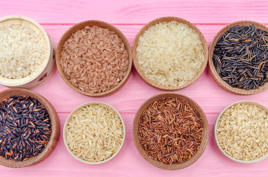 Assortment of different rice in bowls: white rice red rice black rice a mixture of wild and brown rice. The whole grain of rice. unpolished rice. Healthy food background.