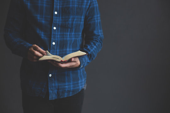 Man reading the Holy Bible.