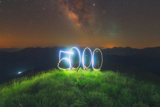 5000 in light painting under the milky way