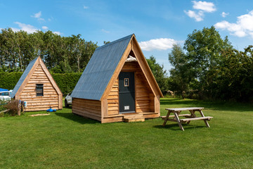 Spoed Foto op Canvas Kamperen Cheltenham, Gloucetsershire, England, UK. July 2019. Wooden camping pods in the Cotswolds region of Gloucestershire
