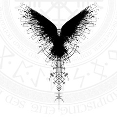 Black grunge bird silhouette with viking symbol on white background