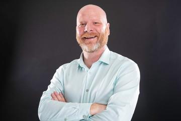 Portrait of friendly bald man with graying beard Wall mural