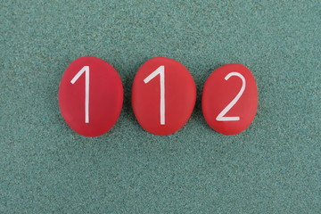Stones design of 112,  phone number for free emergency telephone number in 28 European Union countries over green sand