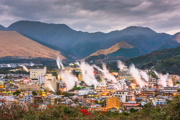 Fototapete - Beppu, Japan cityscape with hot spring bath houses