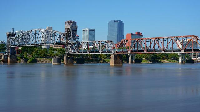 Little Rock, capital of Arkansas, USA. Skyline with Arkansas River at daytime in summer, long exposure.