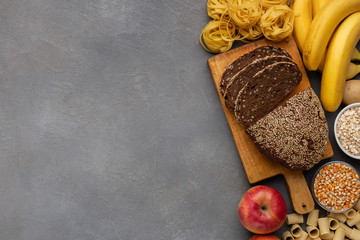 High fibre and carbohydrate food on gray background