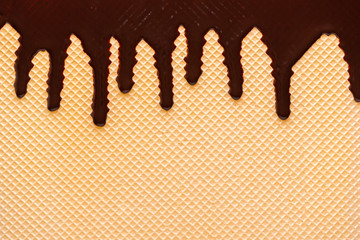 yellow waffle texture with chocolate icing like background for your design