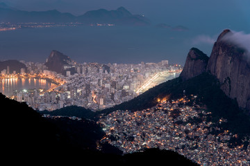 Aerial Night View of a Slum and Ipanema Neighborhood in Rio de Janeiro, Two Different Realities of Brazilian People