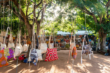 Traditional african market selling colorful  bags hanged on trees, Maputo, Mozambique