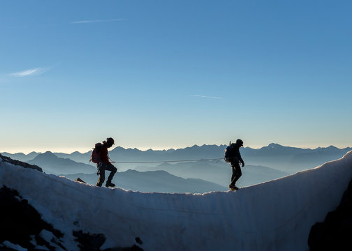 France, Ecrins Alps, two mountaineers at Dauphine