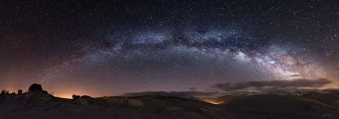 Spain, Milky way over mountains