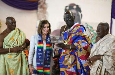 U.S. Speaker of the House Nancy Pelosi poses for a photograph after presenting a gift to Paramount Chief of Cape Coast traditional area, Osabarima Kwesi Atta II, during her visit to a palace used by the Chief