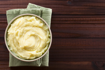 Fresh homemade creamy mashed potato in bowl, photographed overhead with copy space on the right side (Selective Focus, Focus on the potato puree)