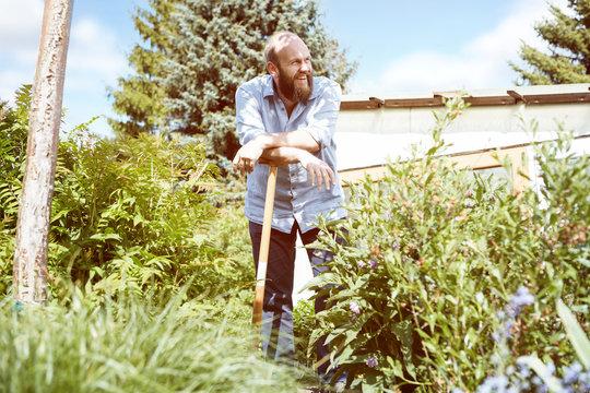 Young man working garden
