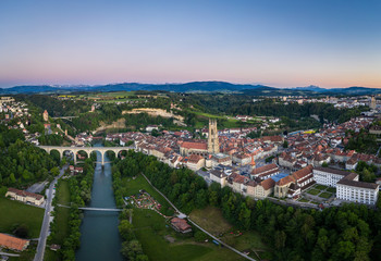 Aerial view of the sunset over Fribourg old town in Switzerland