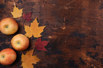 Apple and yellow red maple leaves old grunge wooden background Back to school concept Season school theme Flat lay, top view, copy space