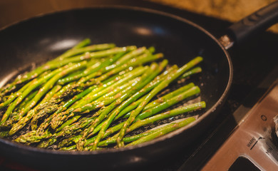 Delicious fine asparagus in a skillet, pan
